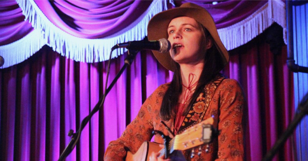 amy goloby performing SXSW red curtains sunflower shirt hat