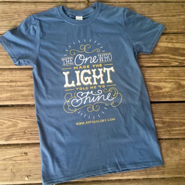 face of god blue t-shirt with lyrics