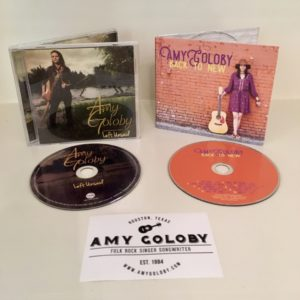 Amy Goloby jewel case Left Unsaid CD and digipak Back to New CD and sticker